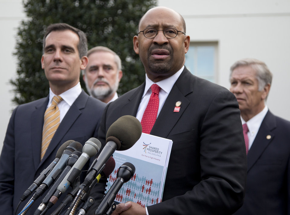 Photo - Philadelphia Mayor Michael Nutter speaks to media outside the White House in Washington, Thursday, Jan. 9, 2014, after an event with President Barack Obama about the Promise Zones Initiative. At left is Los Angeles Mayor Eric Garcetti. The Promise Zone Initiative is part of a plan to create a better bargain for the middle-class by partnering with local communities and businesses to create jobs, increase economic security, expand educational opportunities, increase access to quality, affordable housing and improve public safety. (AP Photo/Carolyn Kaster)