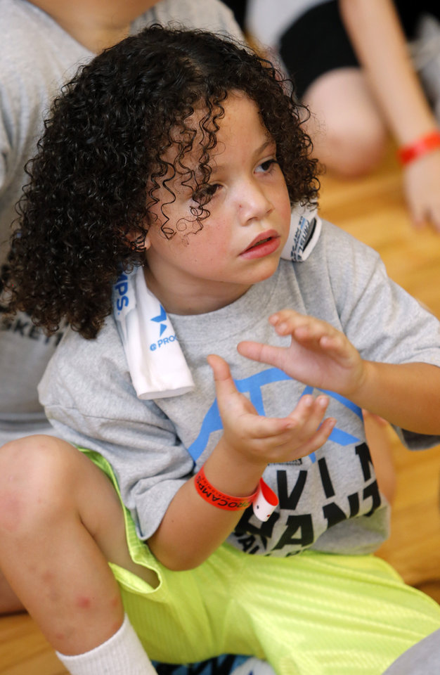 Tyland Thomas, 7, applauds the entrance of star Kevin Durant during Durant's basketball camp on Thursday, Aug. 7, 2014 in Moore, Okla. Photo by Steve Sisney, The Oklahoman