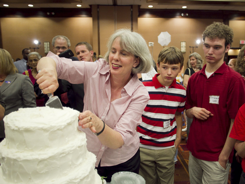 Photo -   Frances Newby slices a wedding cake to celebrate the passage of Amendment One during an election night party in Raleigh, N.C. on Tuesday May 8, 2012. North Carolina voters approved the constitutional amendment Tuesday defining marriage solely as a union between a man and a woman, becoming the latest state to effectively slam the door shut on same-sex marriages. (AP Photo/The News & Observer, Robert Willett) MANDATORY CREDIT