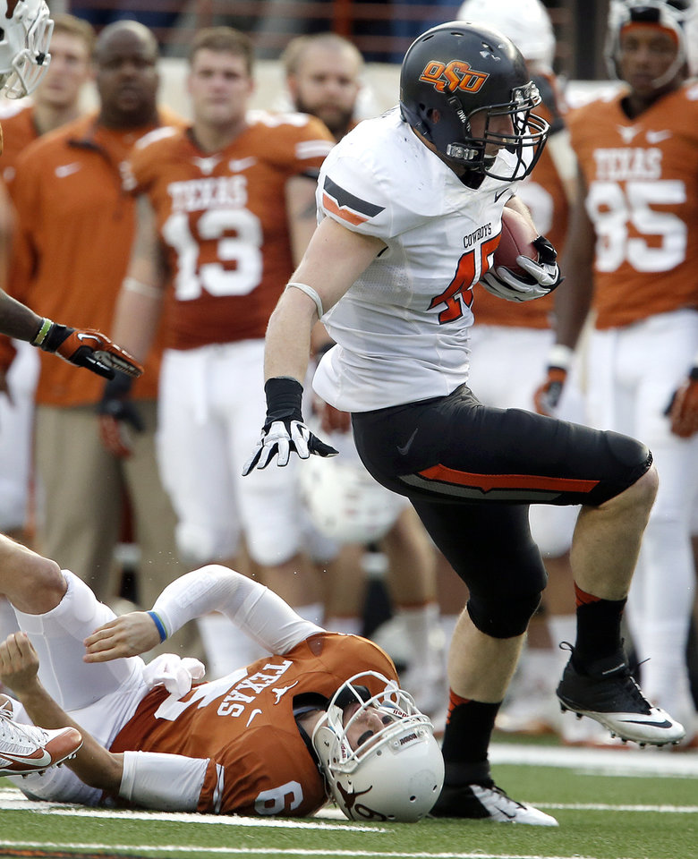 Oklahoma State's Caleb Lavey (45) gets by UT's Case McCoy (6) as returns an interception during a college football game between the Oklahoma State University Cowboys (OSU) and the University of Texas Longhorns (UT) at Darrell K Royal - Texas Memorial Stadium in Austin, Texas, Saturday, Nov. 16, 2013. Photo by Sarah Phipps The Oklahoman