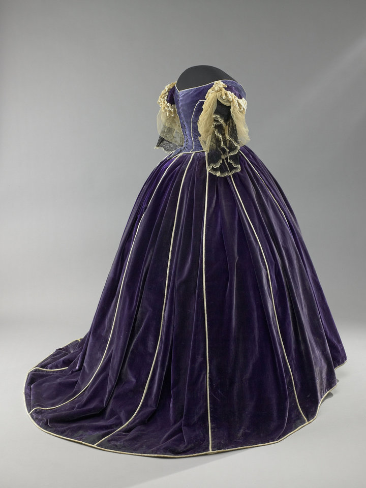 This undated image provided by the Smithsonian�s National Museum of American History shows Mary Todd Lincoln's purple velvet gown from �The First Ladies� exhibit. The gown was made by her seamstress and confidante, Elizabeth Keckley, an African-American woman who had purchased her own freedom. It�s one a number of artifacts associated with President Lincoln and his family in the Smithsonian collection. (AP Photo/Smithsonian�s National Museum of American History)