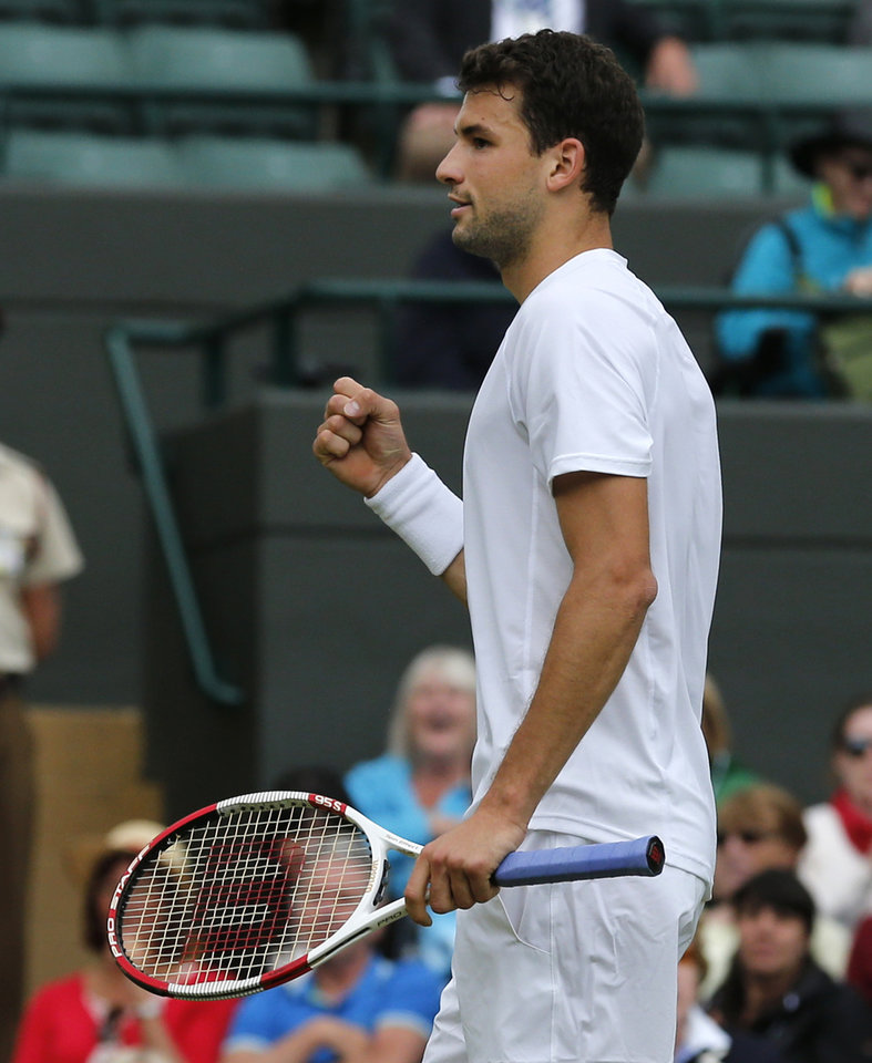 Photo - Grigor Dimitrov of Bulgaria celebrates winning a point against Leonardo Mayer of Argentina during their men's singles match at the All England Lawn Tennis Championships in Wimbledon, London, Monday, June 30, 2014. (AP Photo/Ben Curtis)