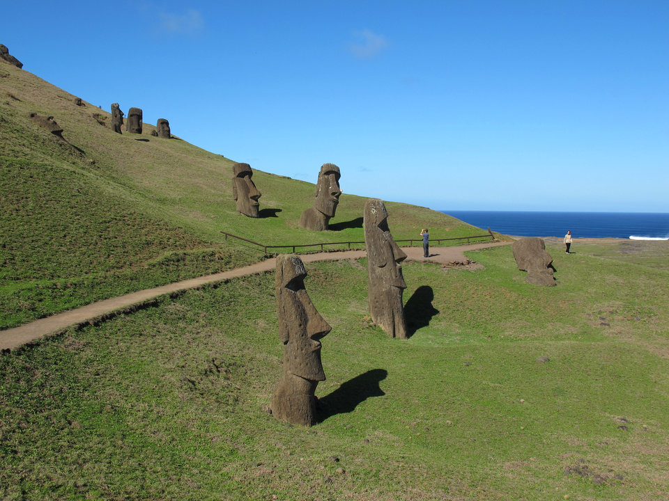 Photo -   This August 2012 photo shows heads at Rano Raraku, the quarry on Easter Island. The sculptures have bodies attached, but they are buried under the dirt and not visible. About 400 moai are here in various stages of carving. (AP Photo/Karen Schwartz)