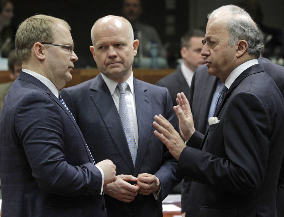 Photo - British Foreign Secretary William Hague, center, listens to French Foreign Minister Laurent Fabius, right, and Estonia's Foreign Minister Urmas Paet, left, during the EU foreign ministers council at the European Council building in Brussels, Monday, March 17, 2014. British Foreign Secretary William Hague says he is confident that the European Union will ratchet up pressure on Russia over its role in the breakaway of Ukraine's Crimea region by imposing sanctions on people linked to the secession of the peninsula. The 28-nation EU condemned the Crimea referendum which overwhelmingly backed a return to Russia, and the EU foreign ministers were assessing on Monday who to target for asset freezes and travel bans. (AP Photo/Yves Logghe)