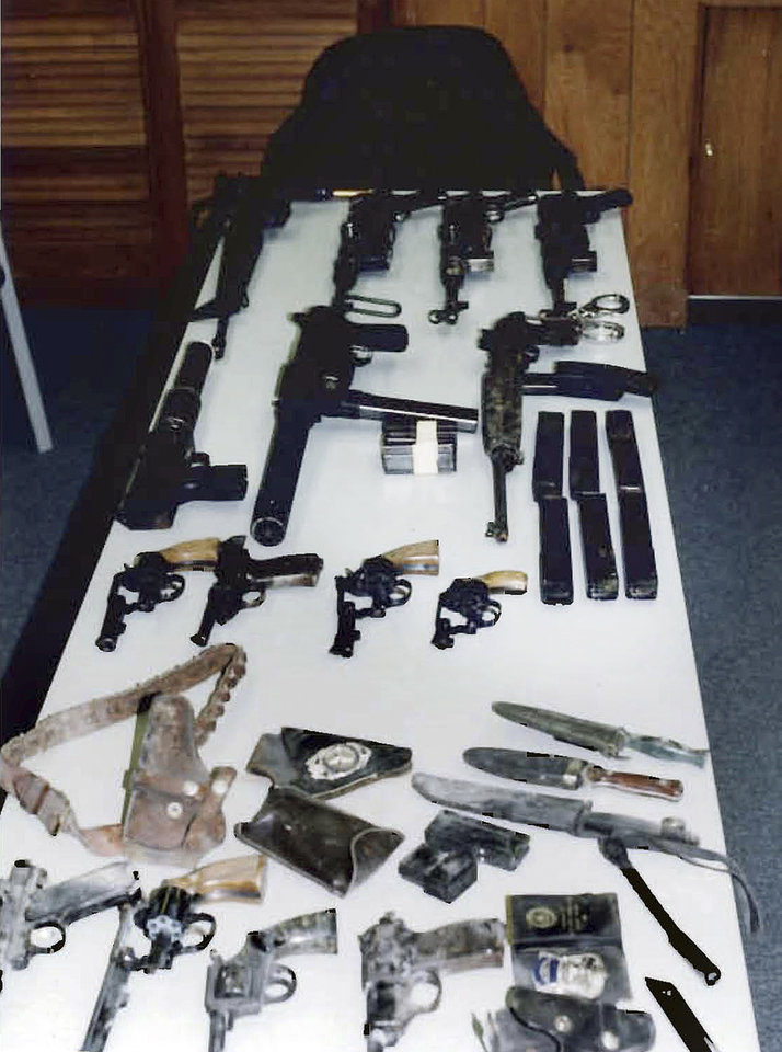 "This undated photo released by the U.S. Attorney's Office and presented as evidence during the trial of James ""Whitey"" Bulger in U.S. District Court in Boston, Thursday, June 13, 2013, shows several weapons from an arsenal that investigators say the Bulger and his gang owned. Bulger is charged with a long list of crimes in a 32-count racketeering indictment, including participating in 19 killings in the 1970s and '80s.  (AP Photo/U.S. Attorney's Office)"