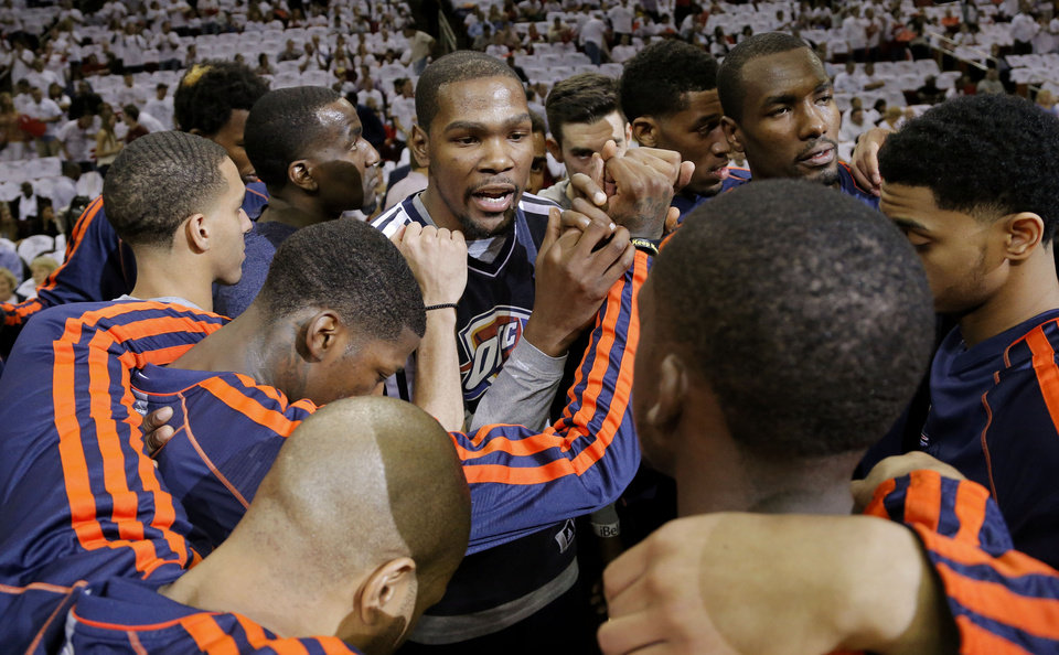 Photo - Oklahoma City's Kevin Durant huddles with teammates before Game 3 in the first round of the NBA playoffs between the Oklahoma City Thunder and the Houston Rockets at the Toyota Center in Houston, Texas, Saturday, April 27, 2013. Photo by Bryan Terry, The Oklahoman