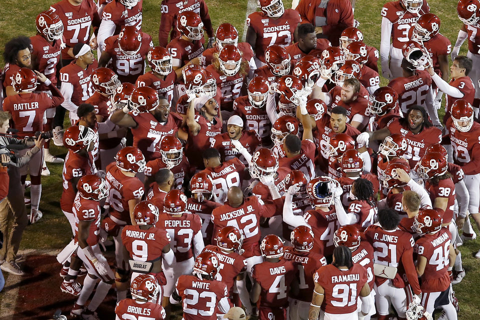 Photo - The Oklahoma team gathers before an NCAA football game between the University of Oklahoma Sooners (OU) and the TCU Horned Frogs at Gaylord Family-Oklahoma Memorial Stadium in Norman, Okla., Saturday, Nov. 23, 2019. Oklahoma won 28-24. [Bryan Terry/The Oklahoman]