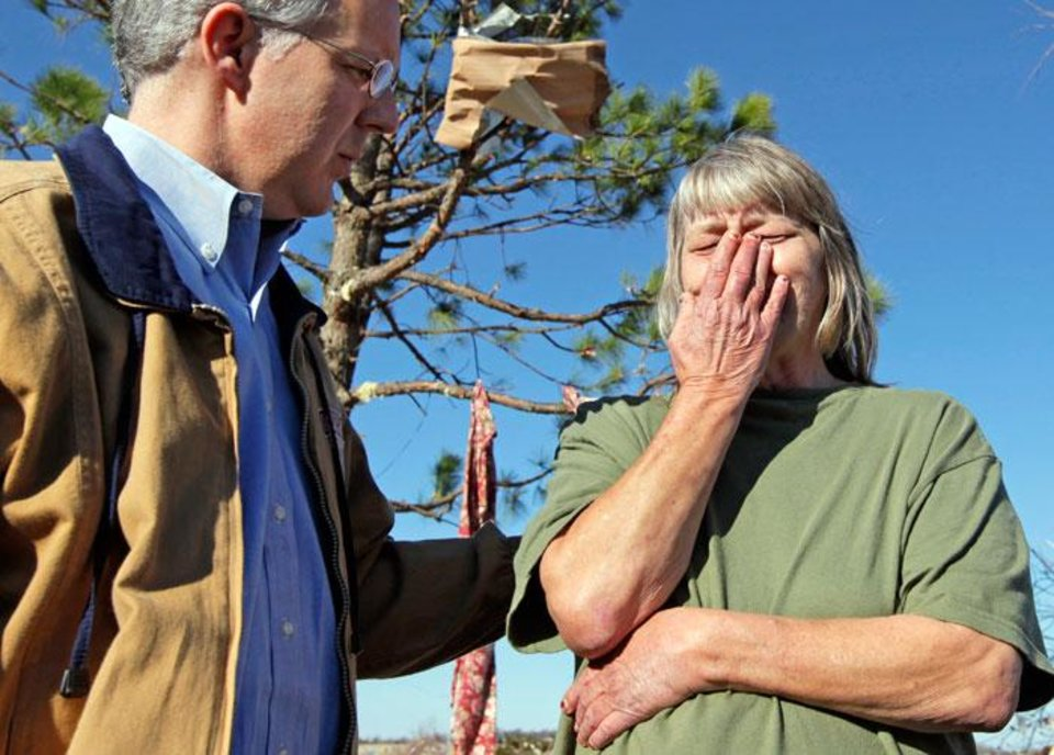 Photo -  Gov. Brad Henry talks with Sue Rose while surveying damage at the Bar K Mobile Home Park in Lone Grove, Okla., Wednesday, February 11, 2009. On Tuesday, February 10, 2009, a tornado moved through Lone Grove killing at least eight people. Rose was unable to seek shelter in time to avoid the tornado and rode out the storm in a mobile home with four other people. The mobile home was damaged, however, the people survived. BY NATE BILLINGS, THE OKLAHOMAN