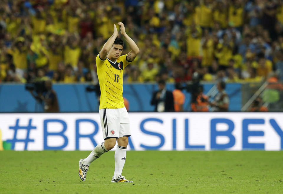Photo - Colombia's James Rodriguez applauds as he replaced after scoring his side's two goals during the World Cup round of 16 soccer match between Colombia and Uruguay at the Maracana Stadium in Rio de Janeiro, Brazil, Saturday, June 28, 2014. (AP Photo/Matt Dunham)