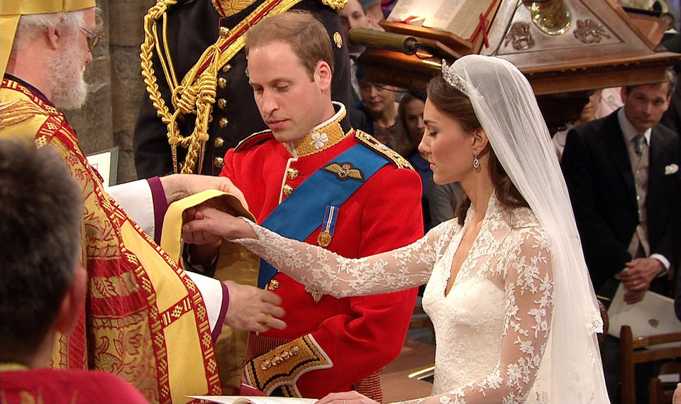 Photo - In this image taken from video, Britain's Prince William, left, stands with his wife, Kate, the Dutchess of Cambridge, as they stand at the altar at Westminster Abbey for the Royal Wedding in London on Friday, April, 29, 2011. (AP Photo/APTN) EDITORIAL USE ONLY NO ARCHIVE PHOTO TO BE USED SOLELY TO ILLUSTRATE NEWS REPORTING OR COMMENTARY ON THE FACTS OR EVENTS DEPICTED IN THIS IMAGE ORG XMIT: RWVM174