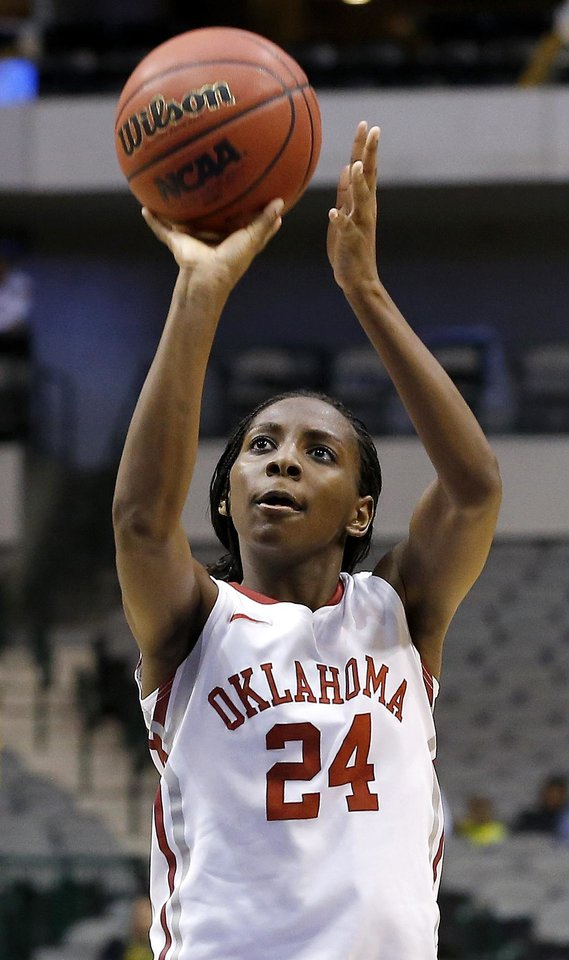 Oklahoma's Sharane Campbell (24) shoots the game-winning free throw during the Big 12 tournament women's college basketball game between the University of Oklahoma and West Virginia at American Airlines Arena in Dallas, Saturday, March 9, 2012. Oklahoma won 65-64.  Photo by Bryan Terry, The Oklahoman
