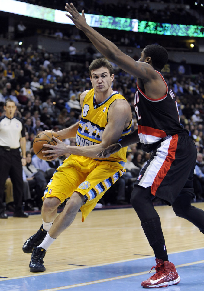 Denver Nuggets forward Danilo Gallinari (8) from Italy drives around Portland Trail Blazers guard Wesley Matthews (2) during the third quarter of an NBA basketball game, Tuesday, Jan. 15, 2013, in Denver. (AP Photo/Jack Dempsey)
