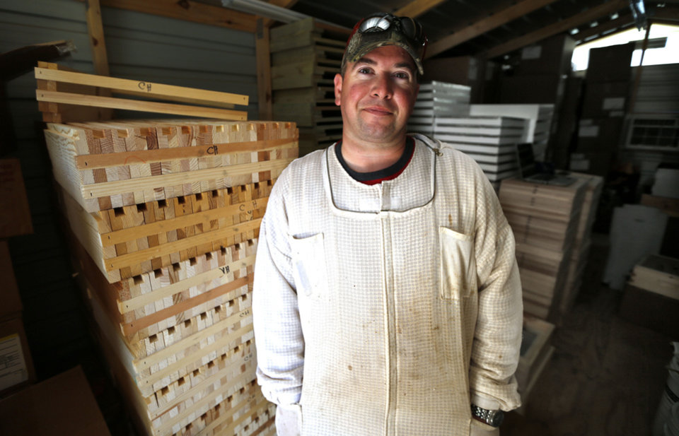 Brian Royal recently talked about beekeeping techniques at a seminar held at his home based business at Norman.  <strong>STEVE SISNEY - THE OKLAHOMAN</strong>