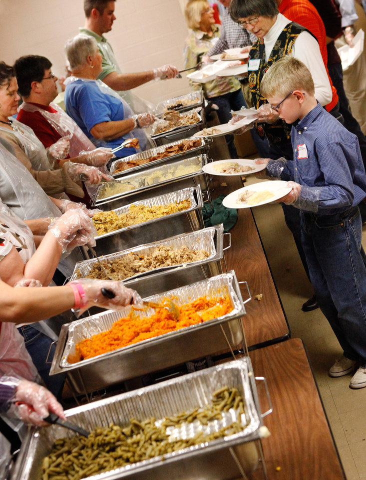 Photo - at the 30th Edmond Community Thanksgiving Dinner in the George Nigh Student Center on the campus of University of Central Oklahoma, Thursday,  Nov. 24, 2011.  Photo by Jim Beckel, The Oklahoman