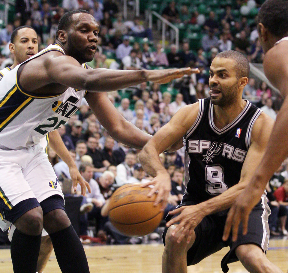 Photo -   San Antonio Spurs point guard Tony Parker (9) of France passes off the ball as Utah Jazz center Al Jefferson (25) pressures during the first half of Game 4 in the first-round NBA basketball playoff series, Monday, May 7, 2012, in Salt Lake City. (AP Photo/Colin E Braley)