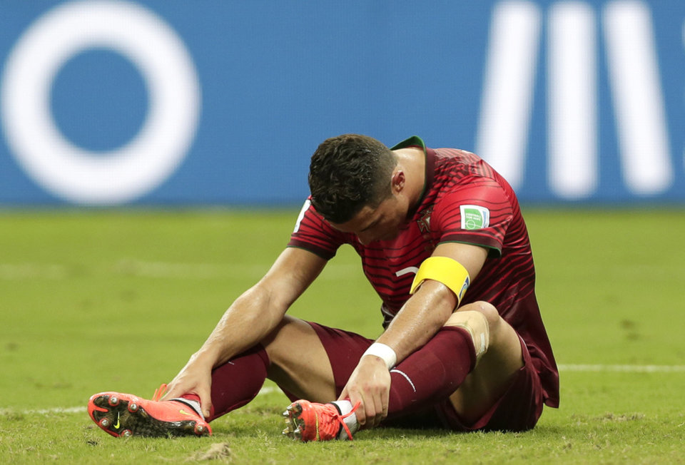 Photo - Portugal's Cristiano Ronaldo bows his head as he reacts to a play during the group G World Cup soccer match between the United States and Portugal at the Arena da Amazonia in Manaus, Brazil, Sunday, June 22, 2014. (AP Photo/Marcio Jose Sanchez)