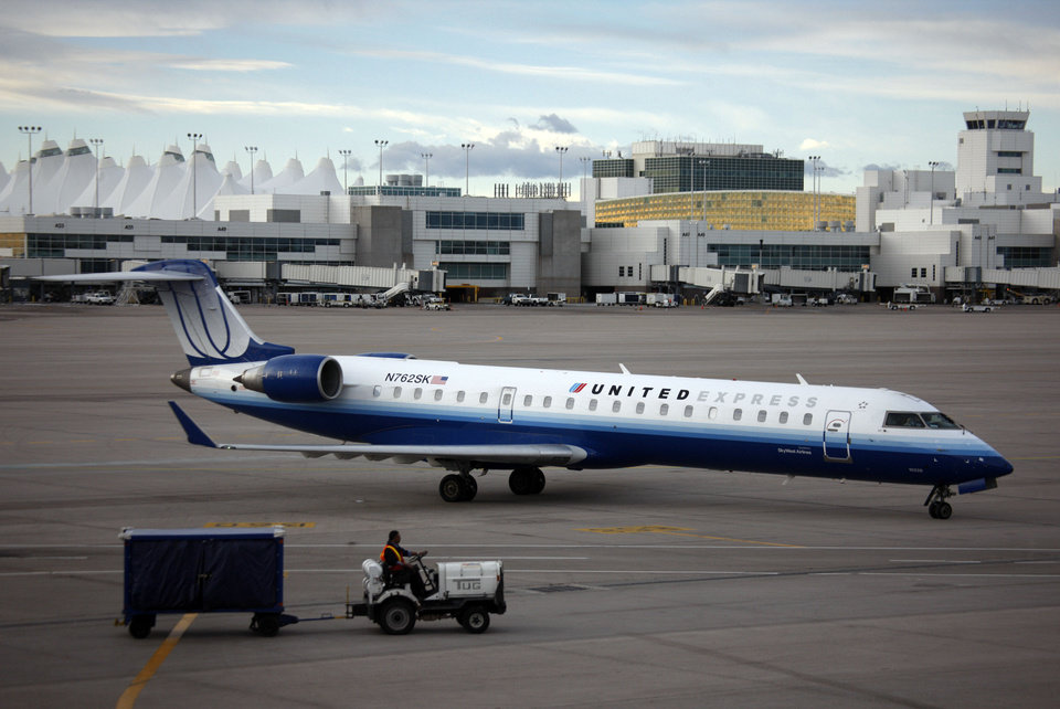 In this file photo, a United Express jetliner backs away from a gate at the terminal of Denver International Airport. United Airlines announced it will add a daily nonstop between Will Rogers World Airport and Cleveland. AP PHOTO <strong>David Zalubowski - AP</strong>