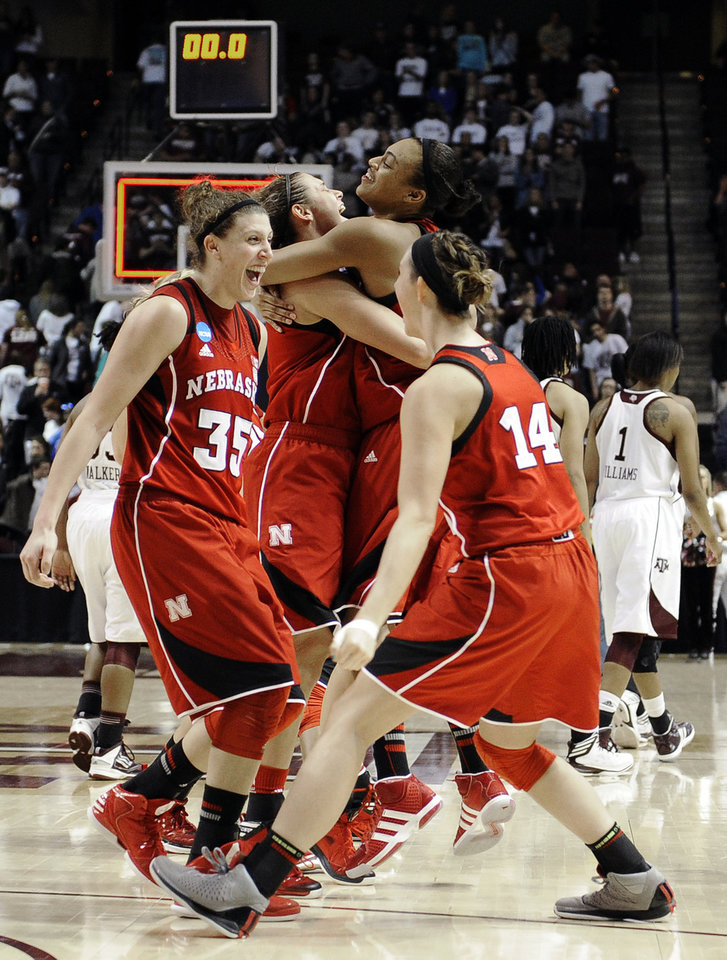 Photo - Nebraska's Jordan Hooper (35) and teammates celebrate their 74-63 win over Texas A&M in a second-round game in the NCAA women's college basketball tournament in College Station, Texas, Monday, March 25, 2013. (AP Photo/Pat Sullivan)