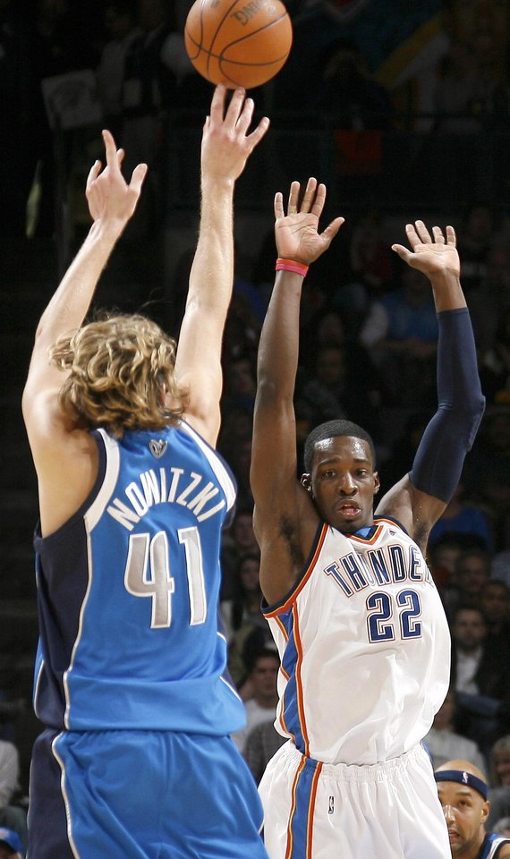 Photo - Dirk Nowitzki of Dallas hits a basket as Oklahoma City's Jeff Green defends during the NBA basketball game between the Oklahoma City Thunder and the Dallas Mavericks at the Ford Center in Oklahoma City on Wednesday, December 16, 2009. Photo by Bryan Terry, The Oklahoman