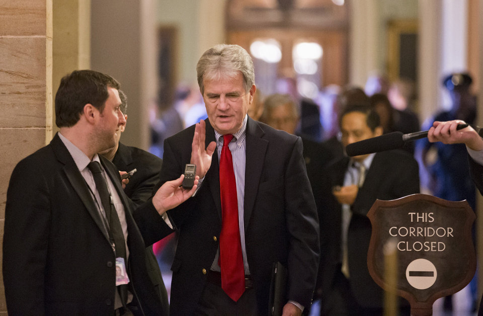 Sen. Tom Coburn, R-Okla., and other Republican senators return to the Capitol in Washington, Friday after a two-hour meeting at the White House with President Barack Obama, trying to come up with a bipartisan solution to the budget stalemate. <strong>J. Scott Applewhite - AP</strong>