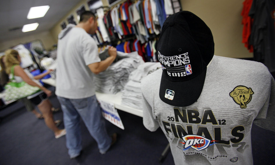 Photo - People shop for Oklahoma City Thunder NBA Finals merchandise at the USA Screen Printing and Embroidery's House of Bedlam shop, 3100 S. Meridian, in Oklahoma City, Wednesday, June 13, 2012. Photo by Nate Billings, The Oklahoman