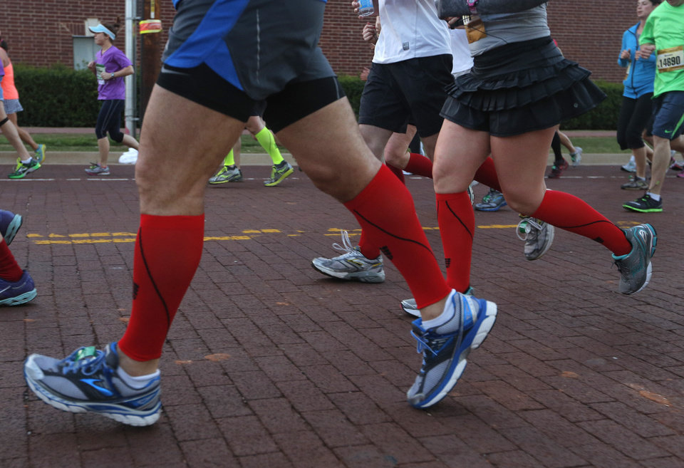 Photo - Runners wear red socks in honor of Boston during the Oklahoma City Memorial Marathon in Oklahoma City, Sunday, April 28, 2013.  Photo by Garett Fisbeck, For The Oklahoman