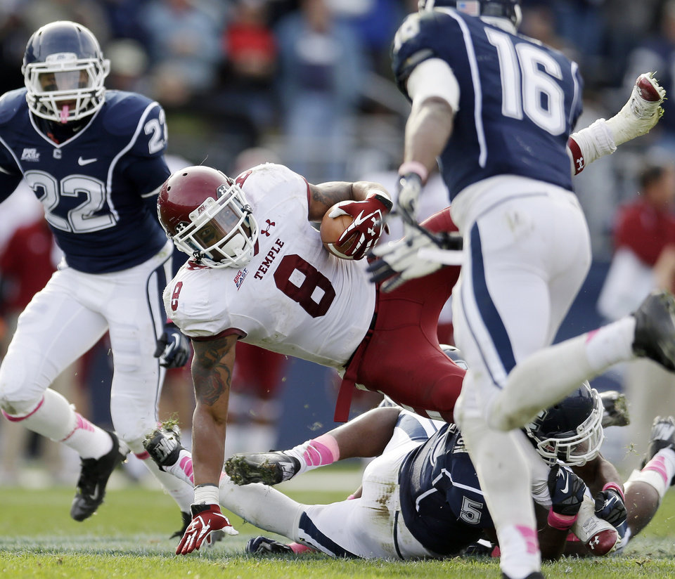 Photo -   Connecticut cornerback Blidi Wreh-Wilson (5) tackles Temple running back Montel Harris (8) in the fourth quarter of an NCAA college football game in East Hartford, Conn., Saturday, Oct. 13, 2012. Temple won 17-14 in overtime. (AP Photo/Michael Dwyer)