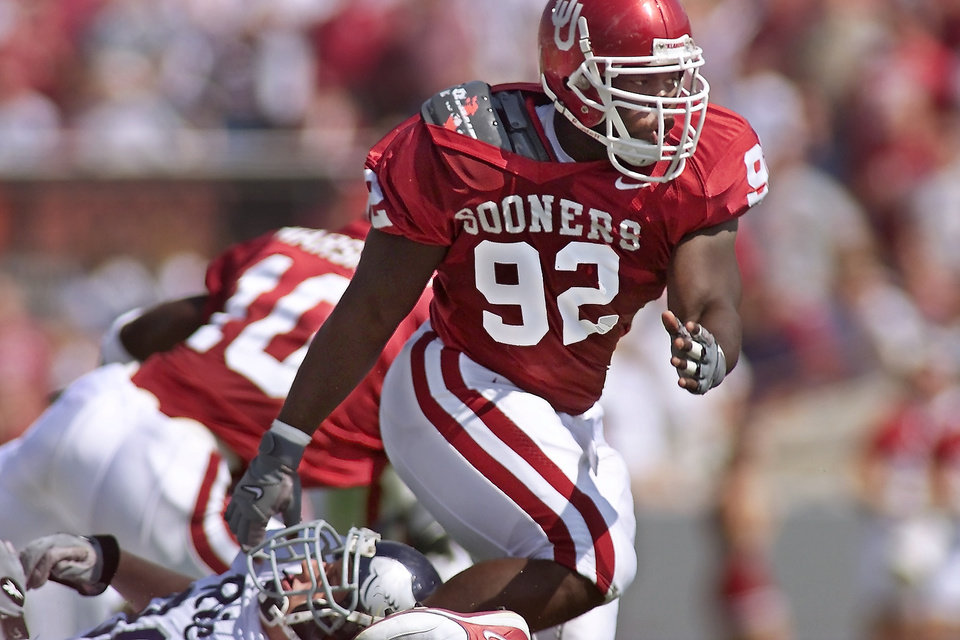 OU FOOTBALL: DE Corey Callens breaks away from block by Brandon Manning in Saturday's game with Rice. (Staff photo by Doug Hoke)