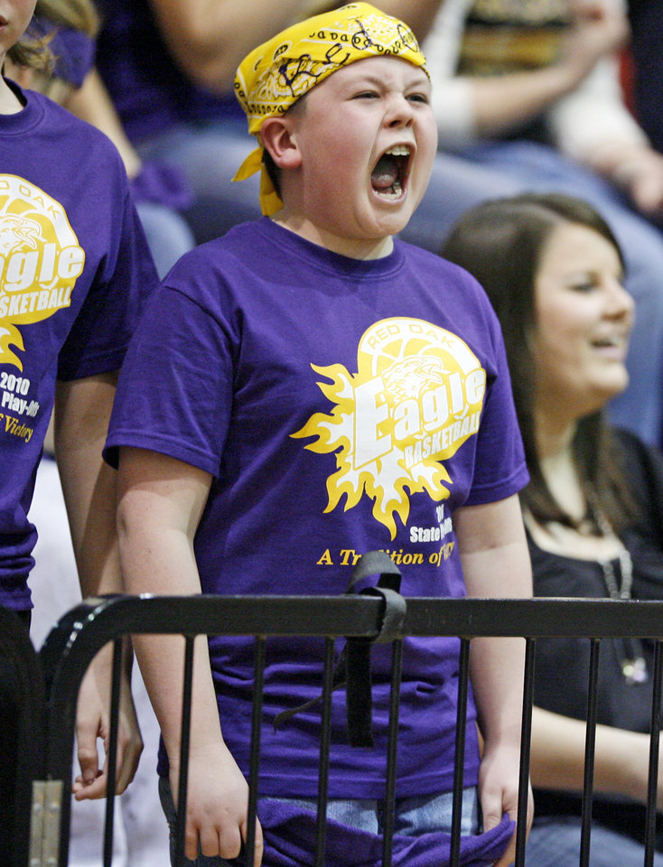 Photo - Kaleb Brewer, 11, of Red Oak cheers for the team as they play Timberlake in the Class B boys state high school basketball tournament at Carl Albert High School in Midwest City, Okla., Thursday, March 4, 2010.  Photo by Bryan Terry, The Oklahoman
