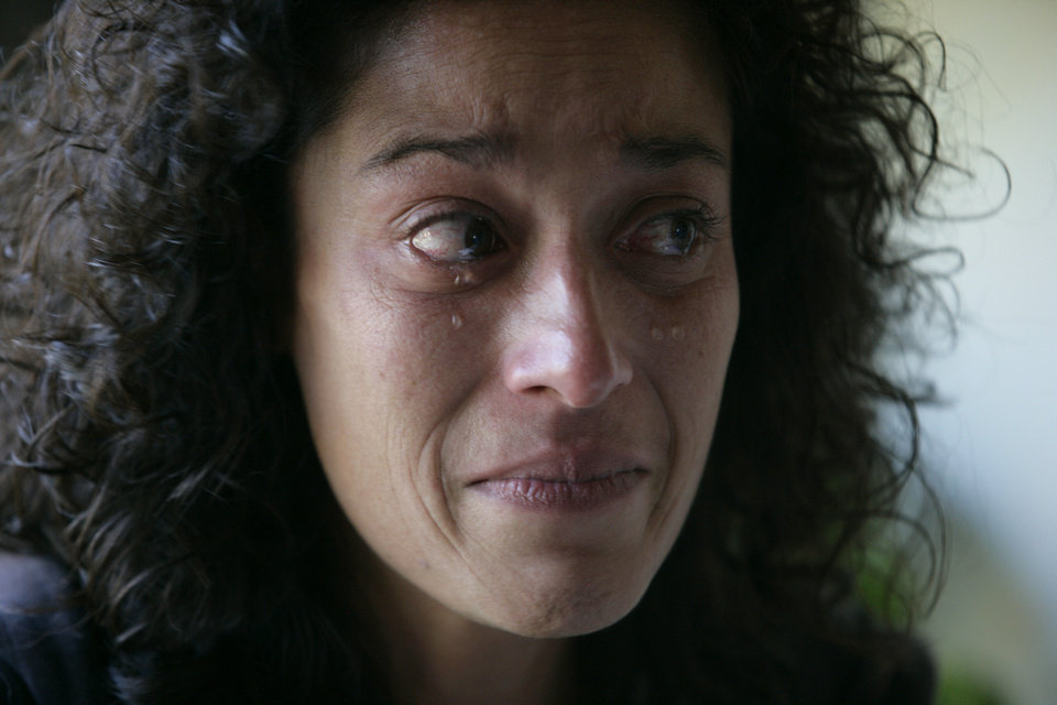 In this Tuesday, Oct. 16, 2012 photo, Andrea Waple cries as she talks about her sister's juvenile life sentence, at her home outside of Columbiaville, Mich. Her older sister, Barbara Hernandez, has been in prison for over two decades after she was sentenced to life without parole. In June 2012, the U.S. Supreme Court delivered a long-awaited ruling, wrestling with questions that have confounded the justice system for years: Should teenagers convicted of the most brutal crimes be punished just like adults? Or should their youth matter? (AP Photo/Al Goldis) ORG XMIT: NY461 <strong>Al Goldis - AP</strong>