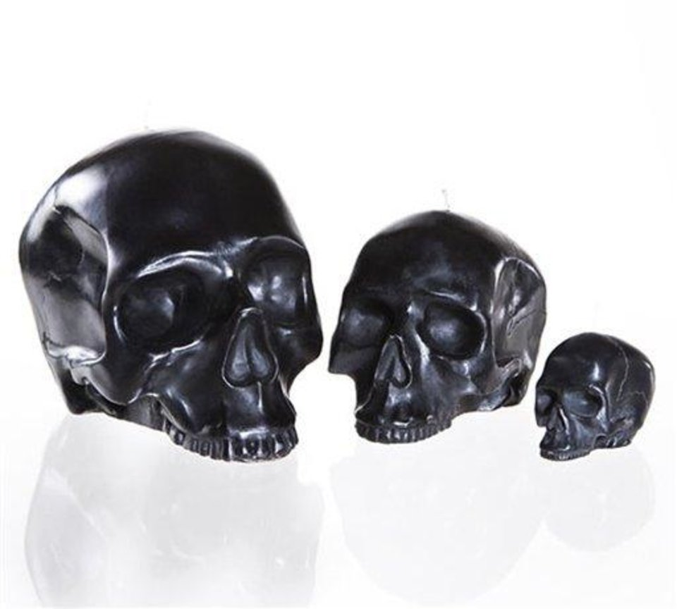 Photo - This product image released by Modern Alchemy shows their sleek, ebony skull candles. This season you'll find lots of ghoulish yet glamorous pieces to decorate with for Halloween.    (AP Photo/Modern Alchemy)