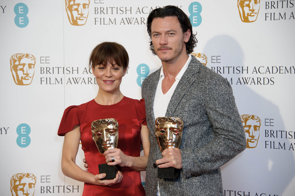 Photo - British actors Helen McCrory, left, and Luke Evans pose for photographers ahead of the EE British Academy Film Awards Nominations announcement in London, Wednesday, Jan. 8, 2014. (Photo by Jonathan Short/Invision/AP)