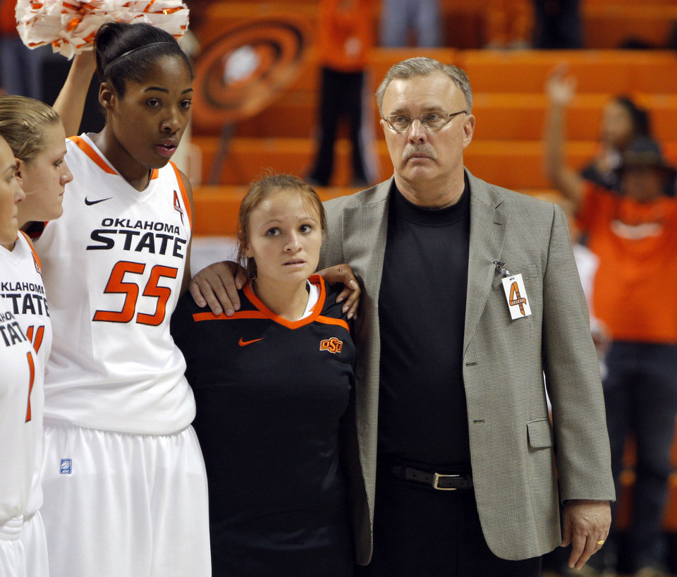 Photo - Interim head coach Jim Littell stands with players following women's college game between Oklahoma State University and Coppin State at Gallagher-Iba Arena in Stillwater, Okla.,  Saturday, Nov. 26, 2011.  Photo by Sarah Phipps, The Oklahoman