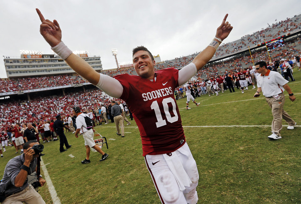 OU\'s Blake Bell (10) celebrates after the Red River Rivalry college football game between the University of Oklahoma (OU) and the University of Texas (UT) at the Cotton Bowl in Dallas, Saturday, Oct. 13, 2012. OU won, 63-21. Photo by Nate Billings, The Oklahoman