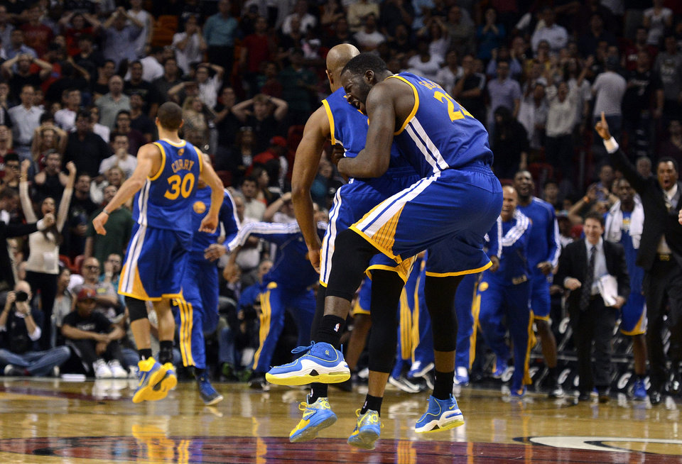 Golden State Warriors' Draymond Green (23) celebrates with teammate Jarrett Jack against the Miami Heat during an NBA basketball game on Wednesday, Dec. 12, 2012, in Miami. The Warriors won 97-95. (AP Photo/Rhona Wise) ORG XMIT: AAA108