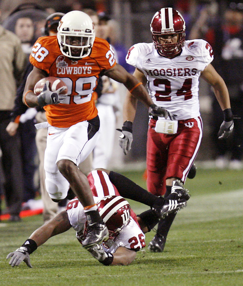 Photo - Oklahoma State's Jon Morris (28) outruns Indiana's Brandon Mosley (26) and J.T. Owens (24) after a pass reception in the second half during the Insight Bowl college football game between Oklahoma State University (OSU) and the Indiana University Hoosiers (IU) at Sun Devil Stadium on Monday, Dec. 31, 2007, in Tempe, Ariz.   BY NATE BILLINGS, THE OKLAHOMAN ORG XMIT: KOD