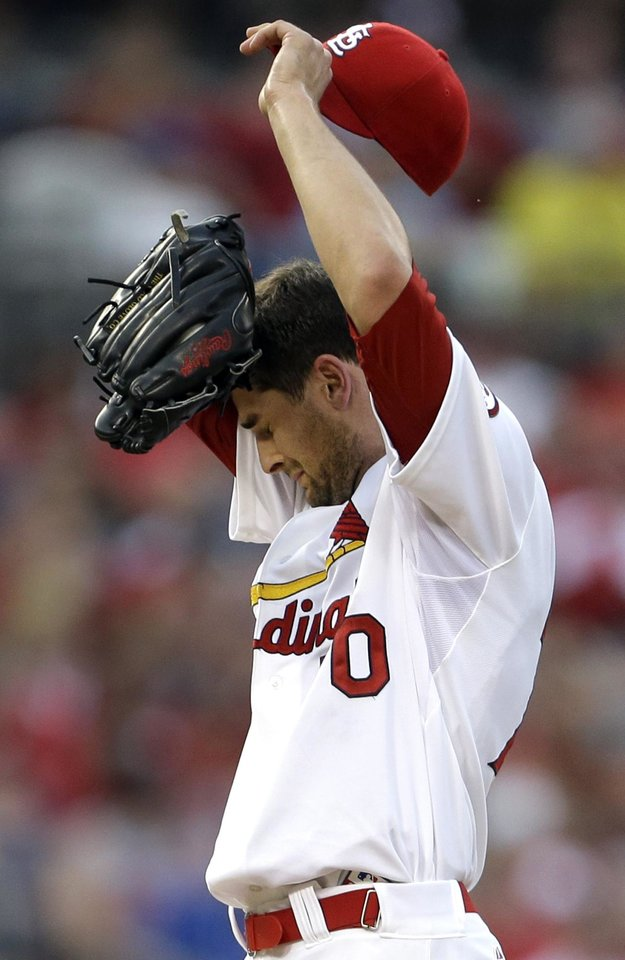 St. Louis Cardinals starting pitcher Tyler Lyons pauses on the mound during the second inning of a baseball game against the Texas Rangers, Friday, June 21, 2013, in St. Louis. (AP Photo/Jeff Roberson)