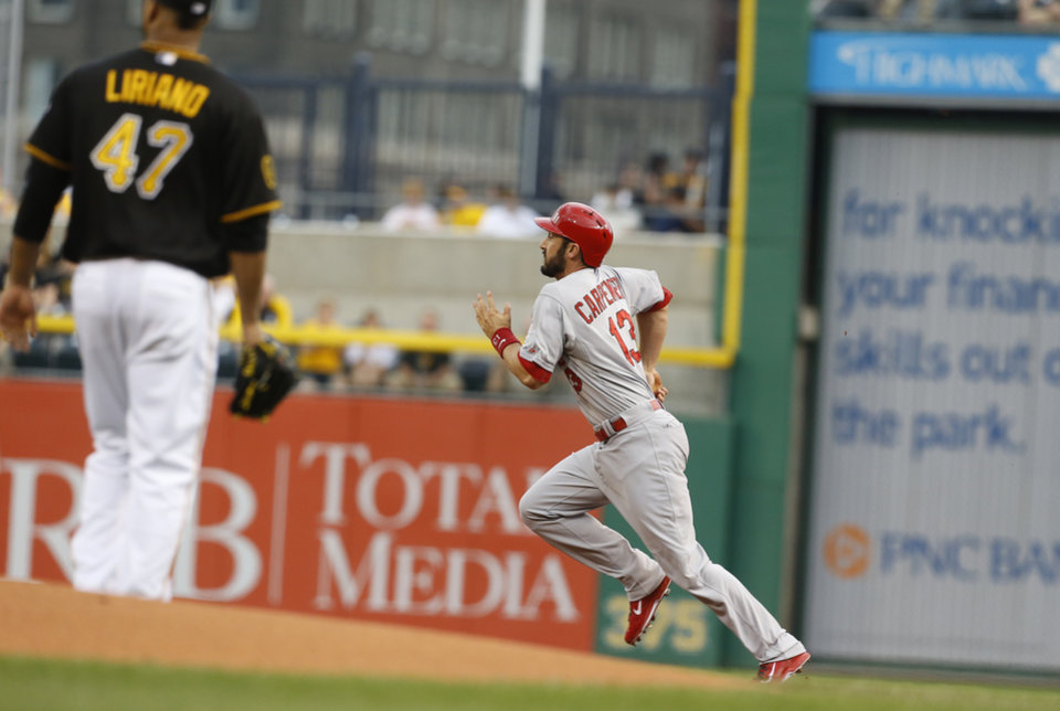 Photo - St. Louis Cardinals' Matt Carpenter (13) heads for second past Pittsburgh Pirates starting pitcher Francisco Liriano with a leadoff double in the first inning of a baseball game on Friday, May 9, 2014, in Pittsburgh. (AP Photo/Keith Srakocic)