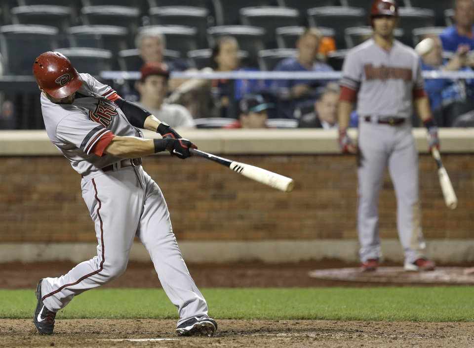 Photo - Arizona Diamondbacks' Cody Ross hits a solo home run during the 13th inning of the baseball game against the New York Mets at Citi Field, Monday, July 1, 2013, in New York. (AP Photo/Seth Wenig)