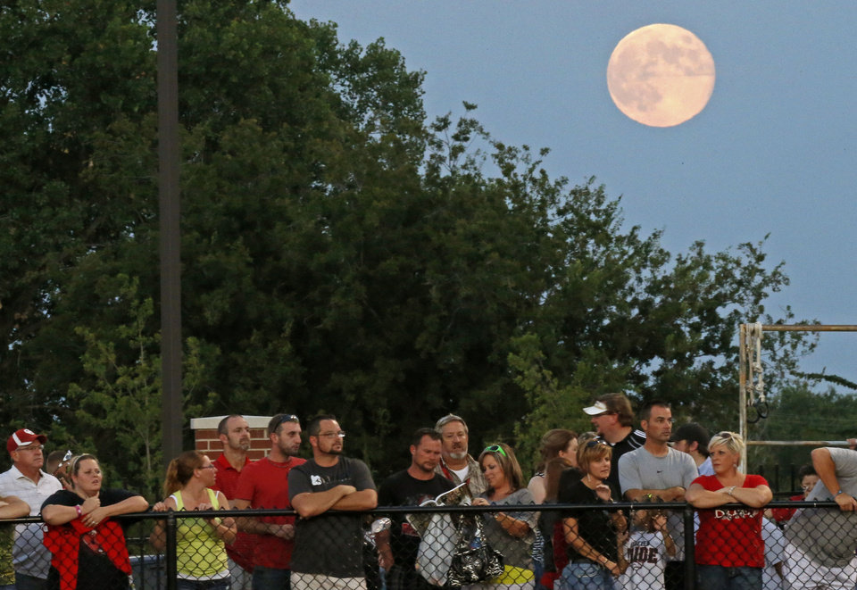 Photo - Fans watch a high school football game between Yukon and Mustang in Yukon, Okla., Friday, August 31, 2012. Photo by Bryan Terry, The Oklahoman