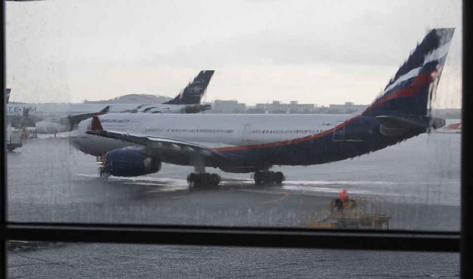 Photo - FILE - In this Monday, July 8, 2013 file photo, an airplane of Aeroflot flight rolls out in preparation for a takeoff seen through a window of Sheremetyevo airport outside Moscow, Russia. The U.S. Homeland Security Department is warning airlines flying to Russia that terrorists may try to smuggle explosives on board hidden in toothpaste tubes. The threat was passed onto airlines that have direct flights to Russia, including some that originate in the United States, according to a law enforcement official speaking Wednesday, Feb. 5, 2014 on condition of anonymity because he was not authorized to discuss details of the warning. (AP Photo/Alexander Zemlianichenko, file)