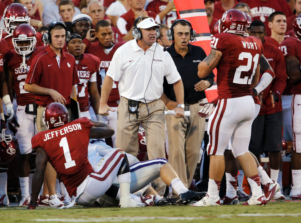 Photo - Defensive coordinator Mike Stoops is upset with his defense during a college football game between the University of Oklahoma Sooners (OU) and the Kansas State University Wildcats (KSU) at Gaylord Family-Oklahoma Memorial Stadium, Saturday, September 22, 2012. Photo by Steve Sisney, The Oklahoman