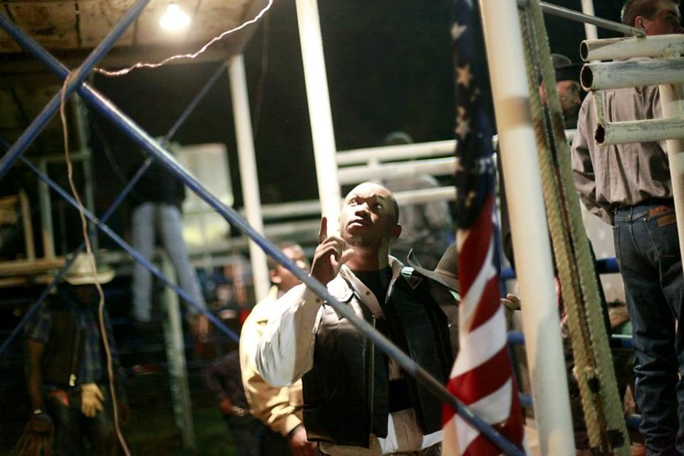 Jamelle Knight prays underneath the press box before he rides a bull during the Annual Spring Jam Spencer Rodeo in Spencer, Oklahoma on Saturday, May 14, 2011. Photo by John Clanton, The Oklahoman