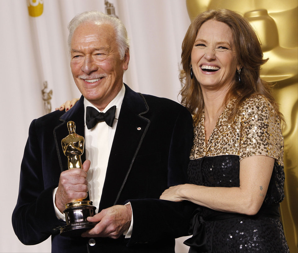 "** EMBARGOED AT THE REQUEST OF THE ACADEMY OF MOTION PICTURE ARTS & SCIENCES FOR USE UPON CONCLUSION OF THE ACADEMY AWARDS TELECAST **Christopher Plummer, left, poses with presenter Melissa Leo and his award for best supporting actor for ""Beginners"" during the 84th Academy Awards on Sunday, Feb. 26, 2012, in the Hollywood section of Los Angeles. (AP Photo/Joel Ryan) ORG XMIT: ACATS142"