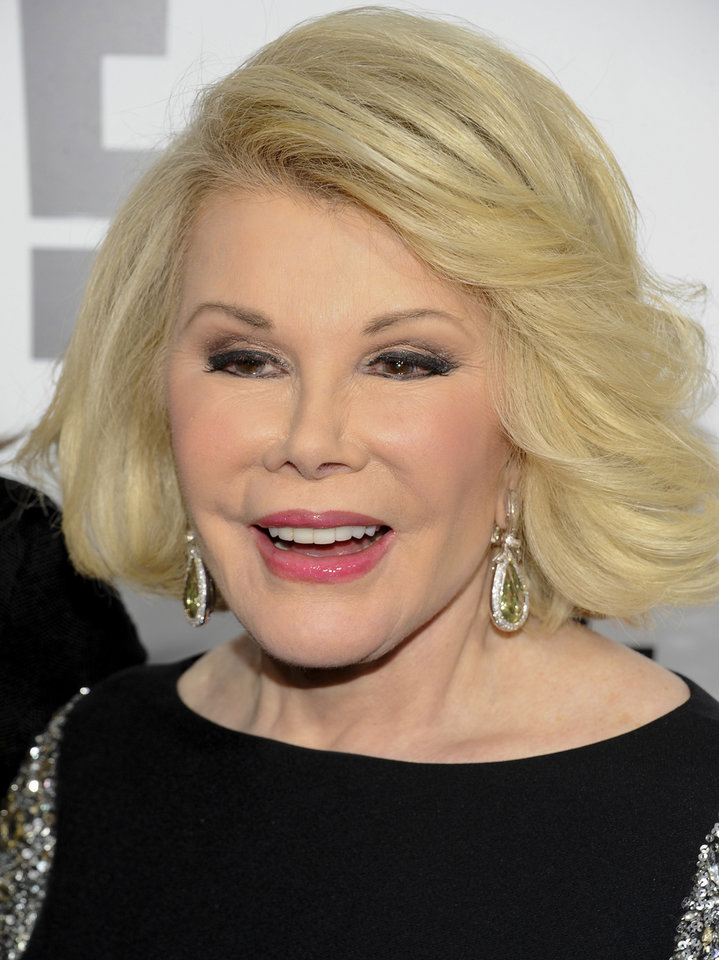 "Photo - FILE - In this April 30, 2012 file photo, Joan Rivers attends an E! Network event in New York. Joan Rivers' family said the comedian has been moved from intensive care into a private room, where she is ""being kept comfortable."" No further details were released Wednesday, Sept. 3, 2014, on Rivers' condition. On Tuesday, the family confirmed she was on life support at Mount Sinai Hospital in Manhattan after going into cardiac arrest last Thursday. (AP Photo/Evan Agostini, File)"
