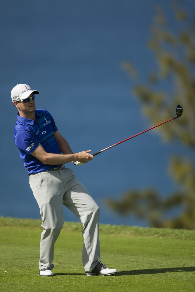 Zach Johnson reacts to his drive on the 13th green during the final round of the Tournament of Champions golf tournament, Monday, Jan. 6, 2014, in Kapalua, Hawaii. (AP Photo/Marco Garcia)