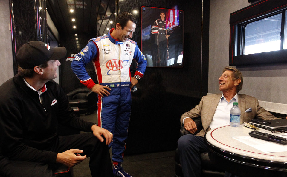 Team Penske President Tim Cindric, left, Helio Castroneves, of Brazil, talk with former NFL quarterback Joe Namath, right, at the Indy Grand Prix of Alabama auto race on Sunday, April 27, 2014, in Birmingham, Ala. (AP Photo/Butch Dill)