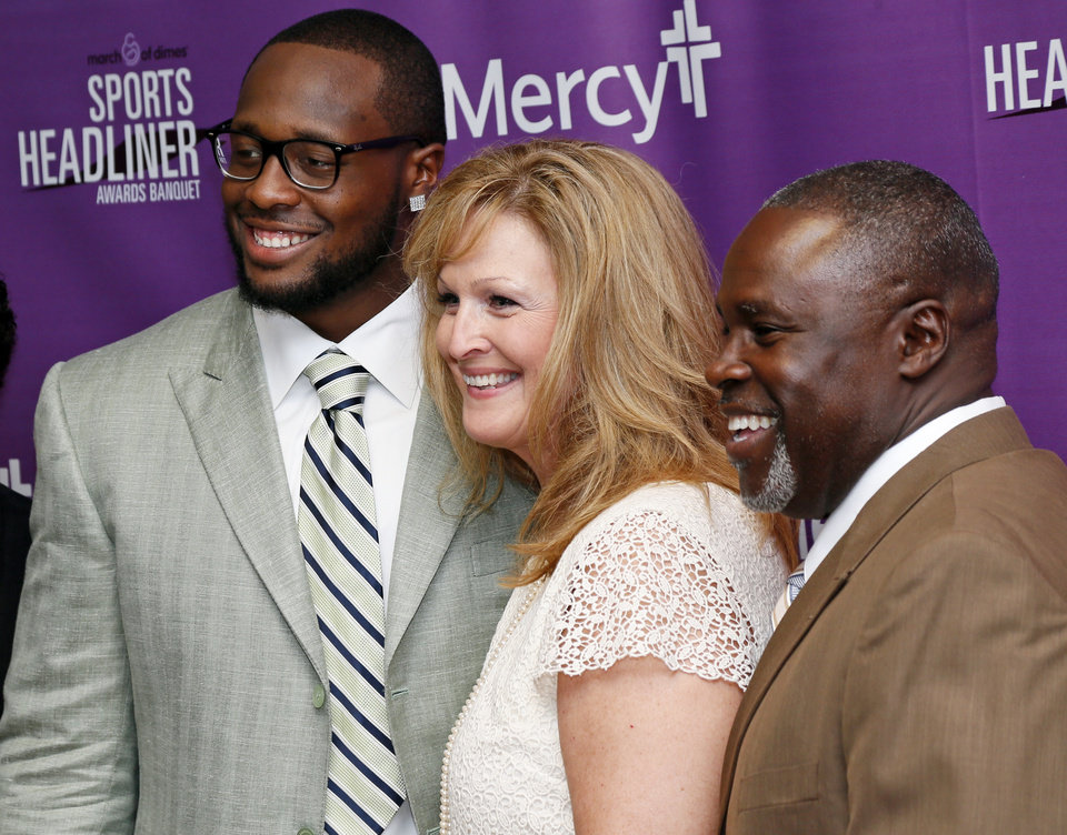 From left, Gerald McCoy of the Tampa Bay Buccaneers, Laurie Applekamp, state director of the March of Dimes, and Gerald McCoy, Sr., pose for a photo during the March of Dimes Sports Headliner Awards Banquet at the Chickasaw Bricktown Ballpark in Oklahoma City, Thursday, June 20, 2013. Photo by Nate Billings, The Oklahoman