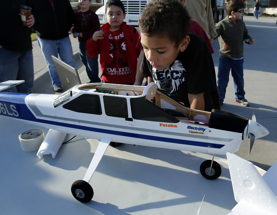 Brayden McGoy, 7, gets a close look at an electric airplane that can be programmed to sample boundary layer atmosphere for the Advanced Radar Research Center during the National Weather Center Weather Festival, on Saturday, Nov. 3, 2012.  Photo by Steve Sisney, The Oklahoman