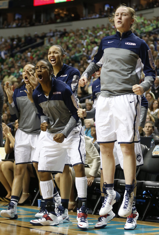Photo - The Connecticut bench cheers against Notre Dame during the first half of the championship game in the Final Four of the NCAA women's college basketball tournament, Tuesday, April 8, 2014, in Nashville, Tenn. (AP Photo/John Bazemore)